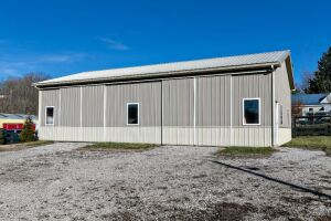 2013 built two-toned 30'x50'x12' metal pole building