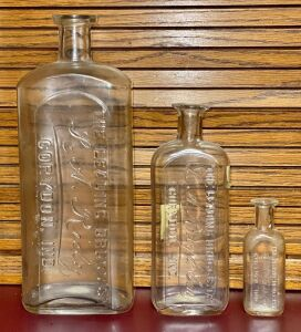 L.A. Riely Druggist Advertising Bottles