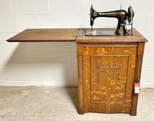 Early Franklin Treadle Sewing Machine in Tiger Oak Cabinet