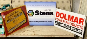 Quikrete, Dolmar Power Products, and Sten Metal Advertising Signs